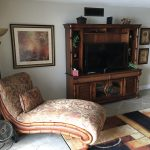 chaise lounge and entertainment center